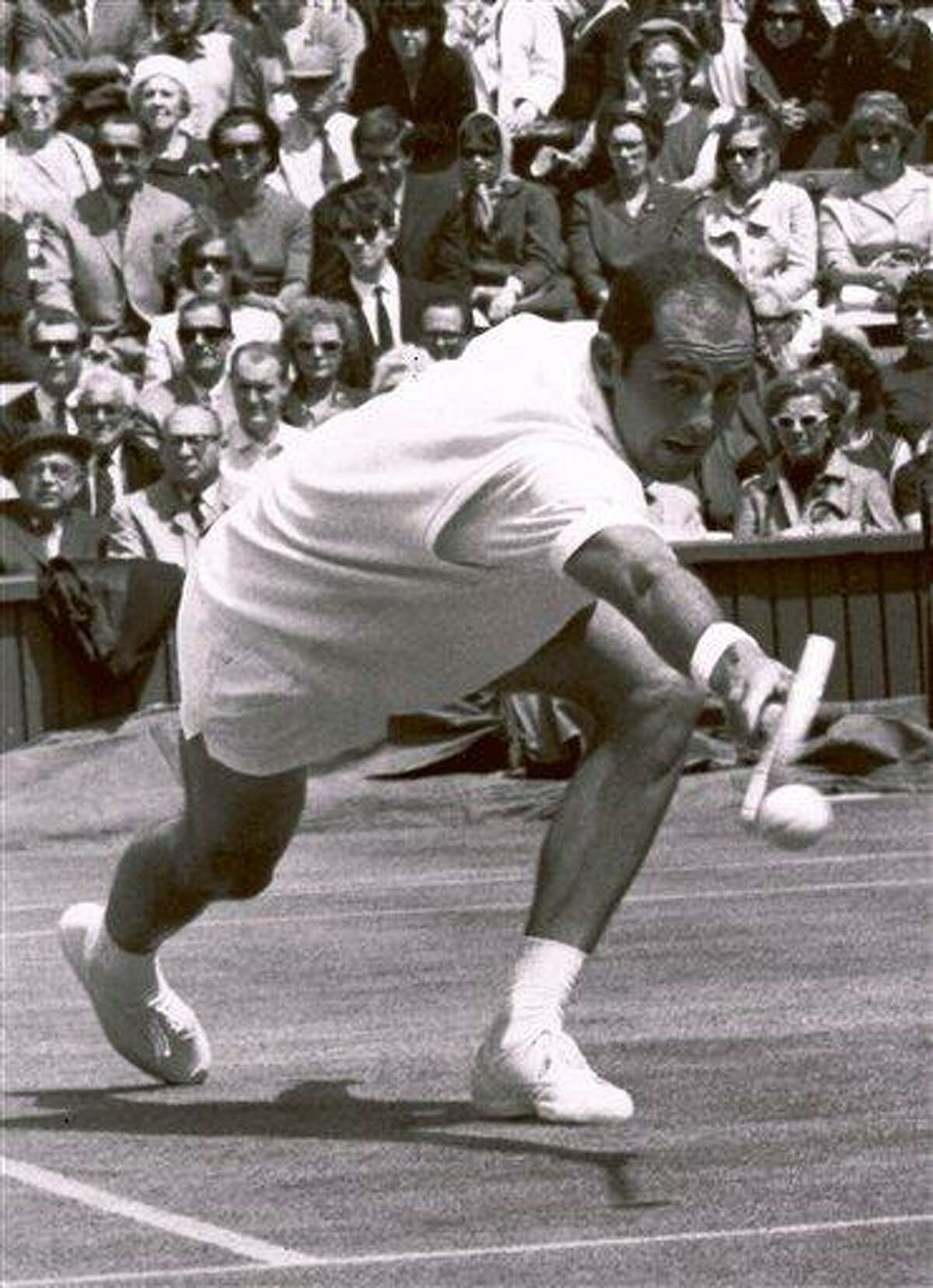 FILE - In this June 26, 1965, file photo, Bob Hewitt competes during a tennis match at Wimbledon, England. The Rhode Island-based International Tennis Hall of Fame has hired a Boston attorney to investigate allegations that one-time doubles champion Hewitt sexually abused underage girls he coached. (AP Photo, File)