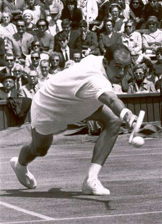 FILE - In this June 26, 1965, file photo, Bob Hewitt competes during a tennis match at Wimbledon, England. The Rhode Island-based International Tennis Hall of Fame has hired a Boston attorney to investigate allegations that one-time doubles champion Hewitt sexually abused underage girls he coached. (AP Photo, File) Photo: AP / AP