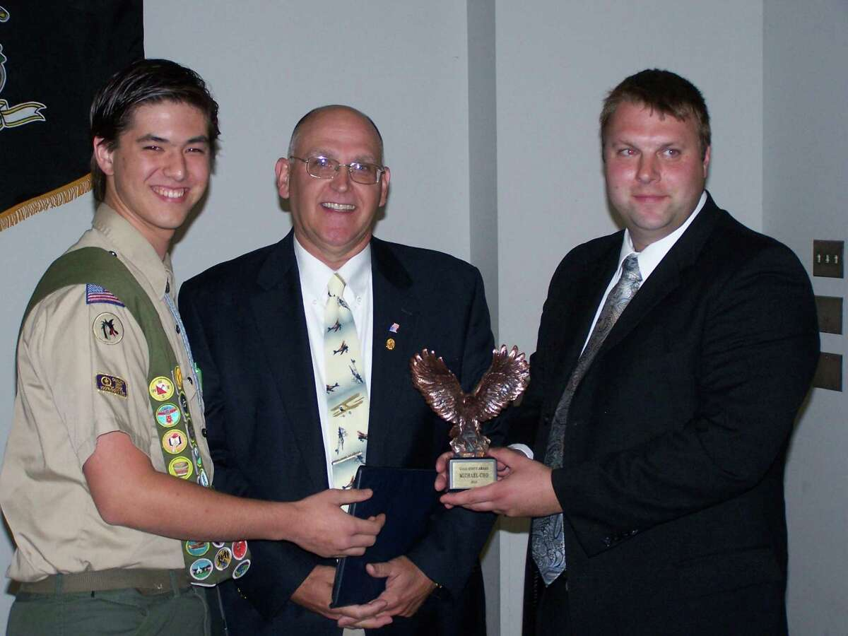 Michael Cho (l.), of Middletown and recipient of the Good Scout Award, Garrell Mullaney (c.), executive director of Adelbrook, and Justin Trzaskos, district executive of Mattabesett Trail District, Connecticut Rivers Council of the Boy Scouts of America.