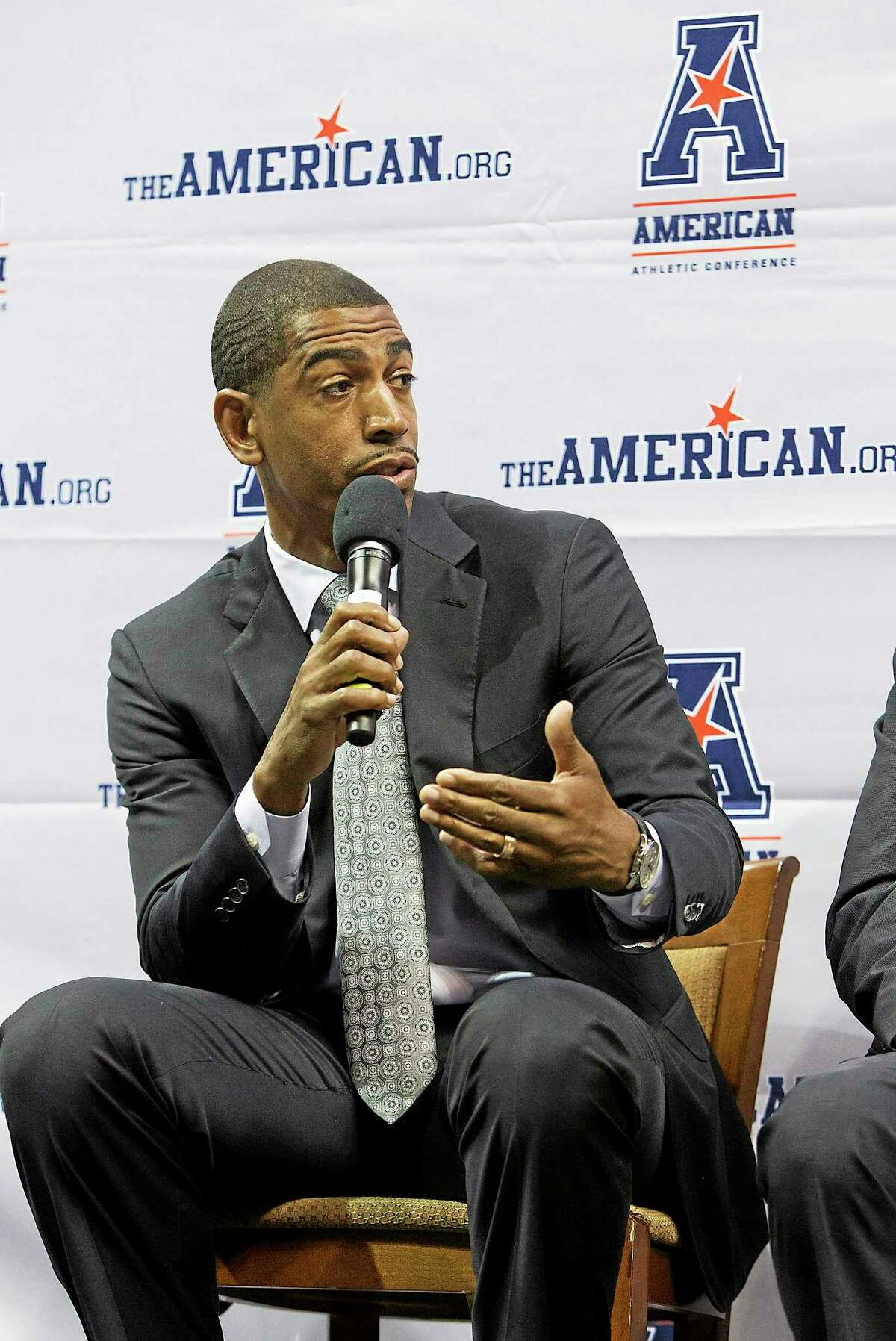 UConn coach Kevin Ollie answers questions at the American Athletic Conference men's basketball media day on Wednesday in Memphis, Tenn.