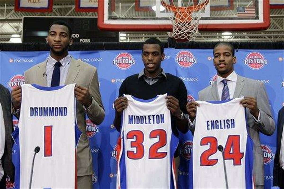 Detroit Pistons draft choices Andre Drummond (1), Khris Middleton (32) and Kim English (24) hold up jerseys while being introduced in Auburn Hills, Mich., Friday, June 29, 2012. (AP Photo/Paul Sancya)