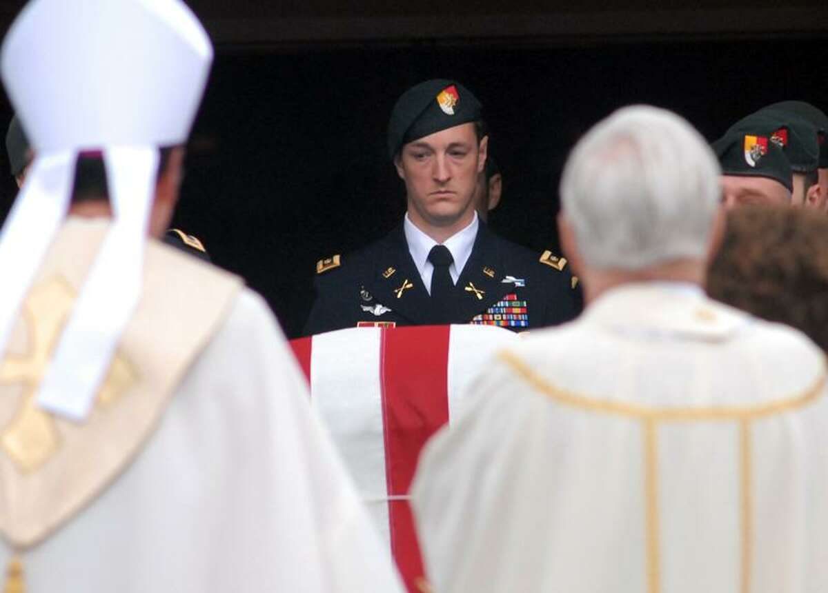 St. George Church, Guilford: A Special Forces pallbearer carried the casket of Capt. Andrew Pedersen-Keel, killed in Afghanistan, out of the church after his funeral. Mara Lavitt/New Haven Register3/25/13