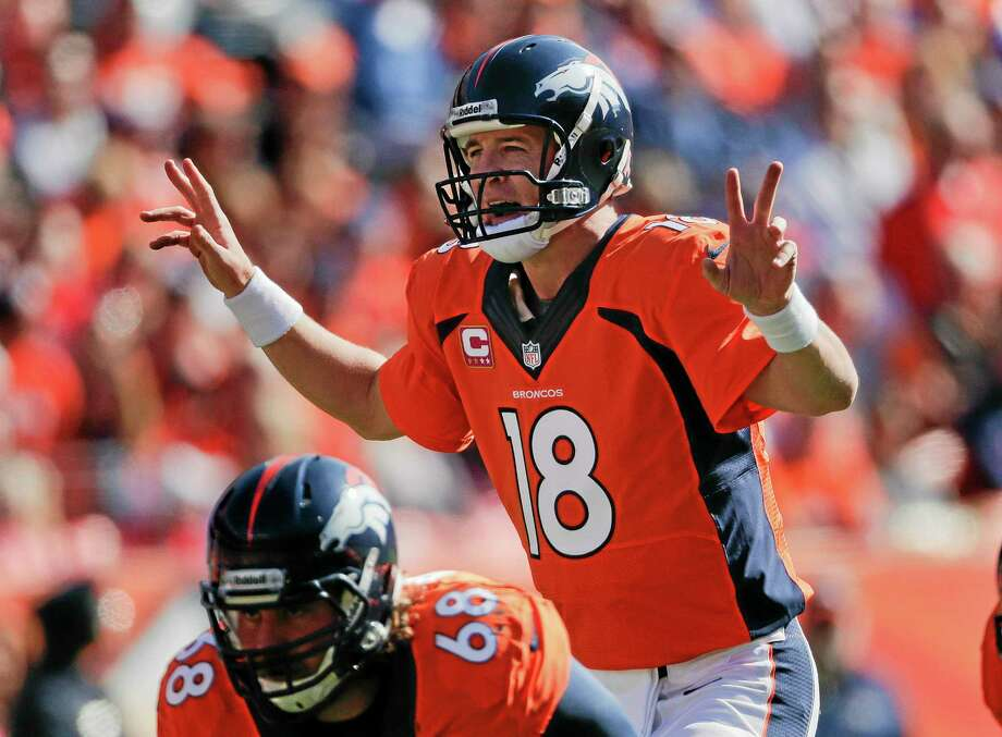 Broncos quarterback Peyton Manning calls an audible at the line of scrimmage against the Jacksonville Jaguars on Sunday in Denver. Photo: Jack Dempsey — The Associated Press  / FR42408 AP