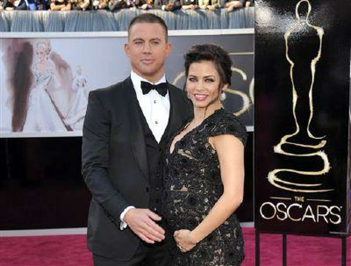 FILE - This Feb. 24, 2013 file photo shows actors Channing Tatum and his pregnant wife Jenna Dewan-Tatum at the 85th Academy Awards at the Dolby Theatre in Los Angeles. in London, where her father is filming the movie