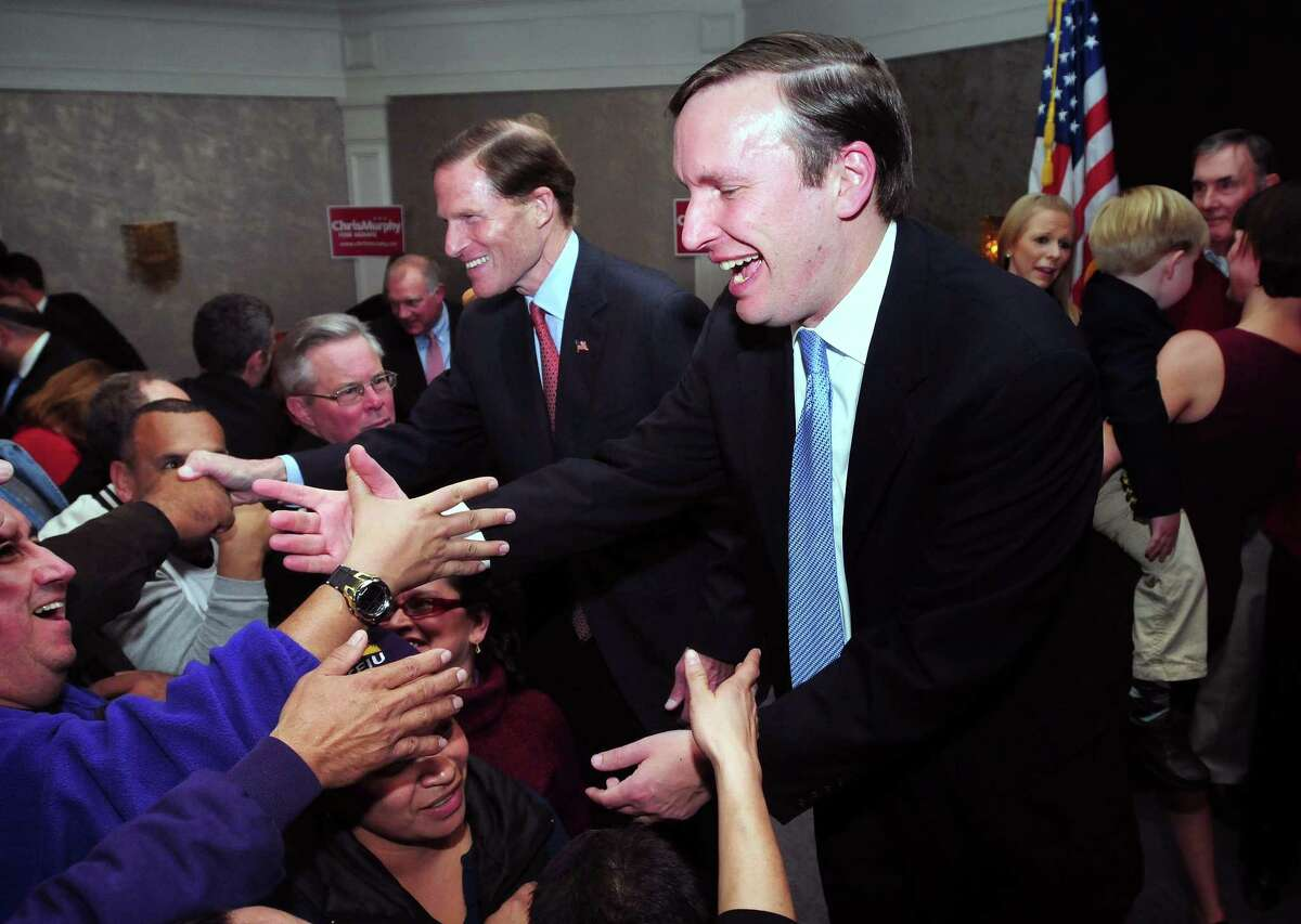 Chris Murphy (right) greets supporters at the Hilton Hotel in Hartford on 11/6/2012 after winning the Senate race over Linda McMahon. At left is U.S. Senator Richard Blumenthal.Photo by Arnold Gold/New Haven Register