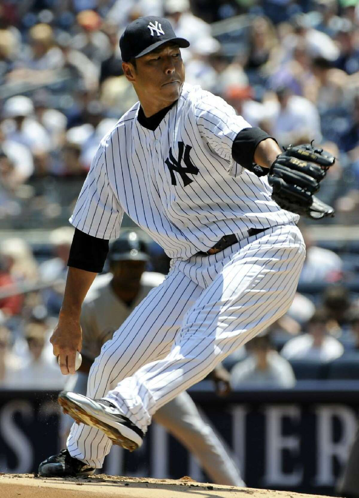 ASSOCIATED PRESS New York Yankees starter Hiroki Kuroda delivers a pitch to the Chicago White Sox during the first inning of Saturday's game at Yankee Stadium in New York. Kuroda struck out 11 and got the win as the Yankees defeated the White Sox 4-0.