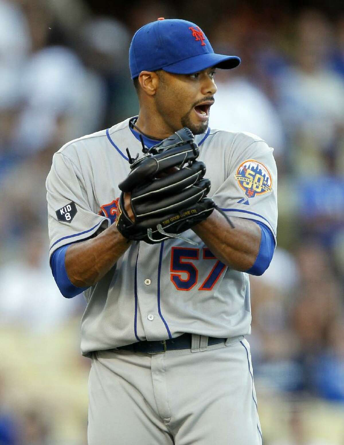 ASSOCIATED PRESS New York Mets starting pitcher Johan Santana (57) lets out a yell after Los Angeles Dodgers' Dee Gordon (not pictured) grounds out to end the eighth inning of Saturday's game in Los Angeles. The Mets won 5-0.