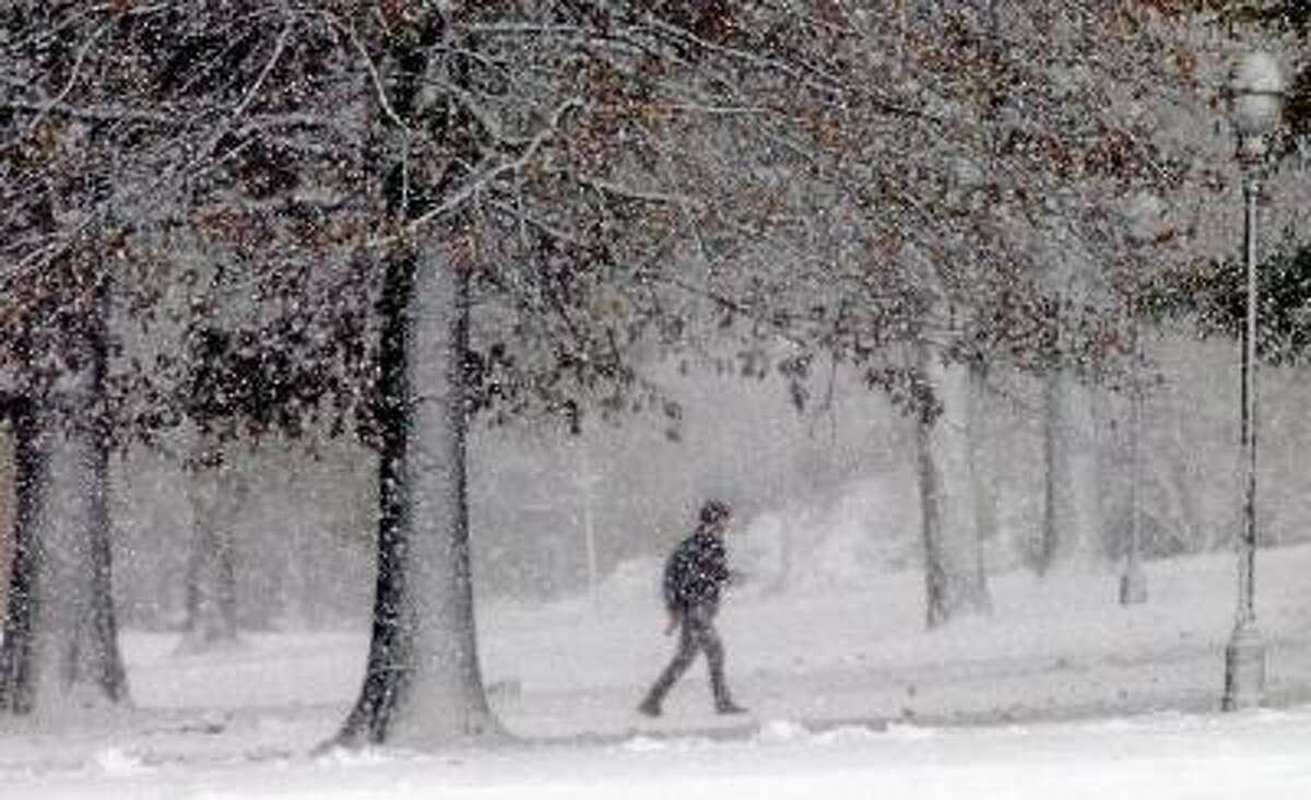Catherine Avalone/The Middletown Press A student walks along 'College Row' at Wesleyan University during the first snowfall of the season caused by the nor'easter Wednesday afternoon.