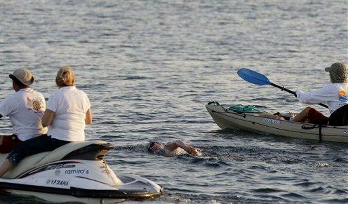 British-Australian swimmer Penny Palfrey begins her bid Friday to complete a record swim from Cuba to Florida, in Havana, Cuba. Palfrey ended her quest for a record on the last 26 miles of her swim early Sunday due to strong currents. Associated Press