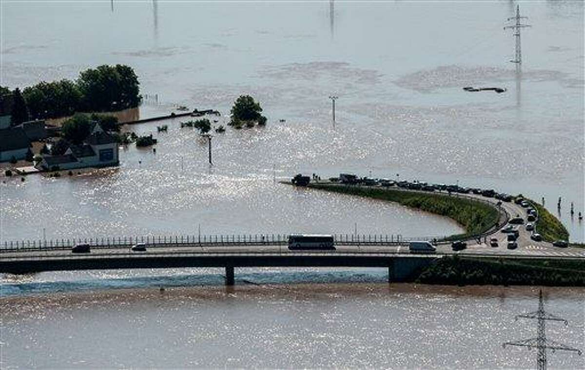 A view from Radobyl hill shows a highway and an exit to the village Mlekojedy flooded by the swollen river Elbe near Litomerice, 70 kilometres (43 miles) Northwest of Prague, taken on Wednesday, June 5, 2013. Heavy rainfalls caused flooding in Germany, Austria, Switzerland and the Czech Republic. (AP Photo/CTK, Radek Petrasek) SLOVAKIA OUT