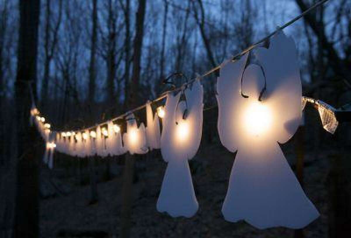 Lighted angels hang from a tree in Monroe, Conn., on Jan. 14, 2013, on the one-month anniversary of the shooting at Sandy Hook elementary School in Newtown that killed 20 children and six staff members. Reuters/Michelle McLoughlin