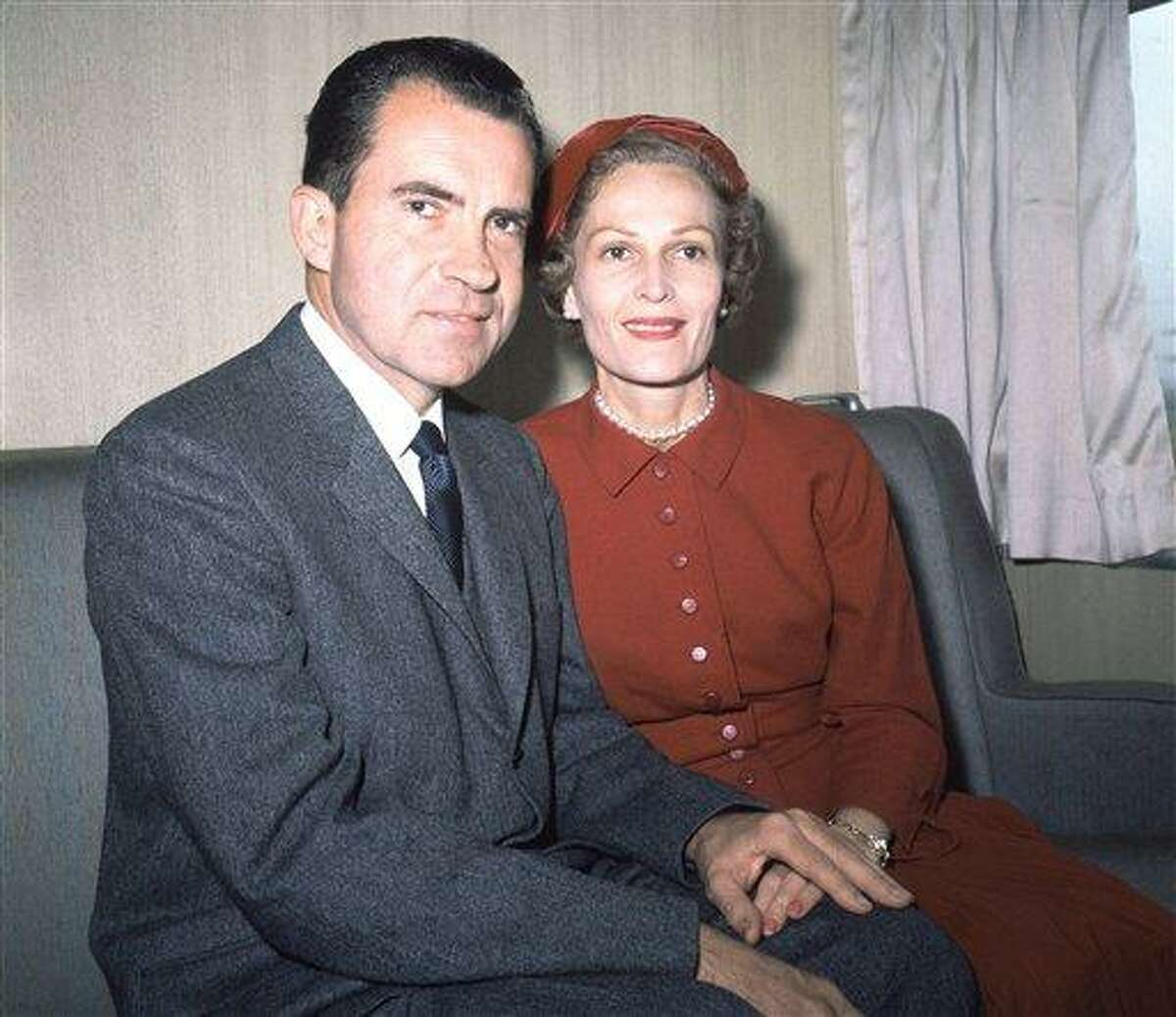 In this June 1960 file photo, former President Richard Nixon, left, and his wife Pat pose for photos while campaigning at Rockefeller Center in New York. Six love letters between the 37th president and his wife will go on display Friday as part of an exhibit at the Richard Nixon Presidential Library and Museum. The exhibit is intended to celebrate what would have been Pat Nixon's 100th birthday and is dedicated to her life and accomplishments. Associated Press