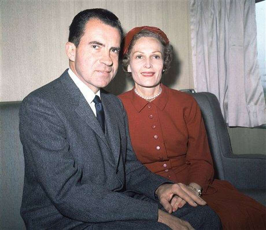 In this June 1960 file photo, former President Richard Nixon, left, and his wife Pat pose for photos while campaigning at Rockefeller Center in New York. Six love letters between the 37th president and his wife will go on display Friday as part of an exhibit at the Richard Nixon Presidential Library and Museum. The exhibit is intended to celebrate what would have been Pat Nixon's 100th birthday and is dedicated to her life and accomplishments. Associated Press Photo: AP / AP1960
