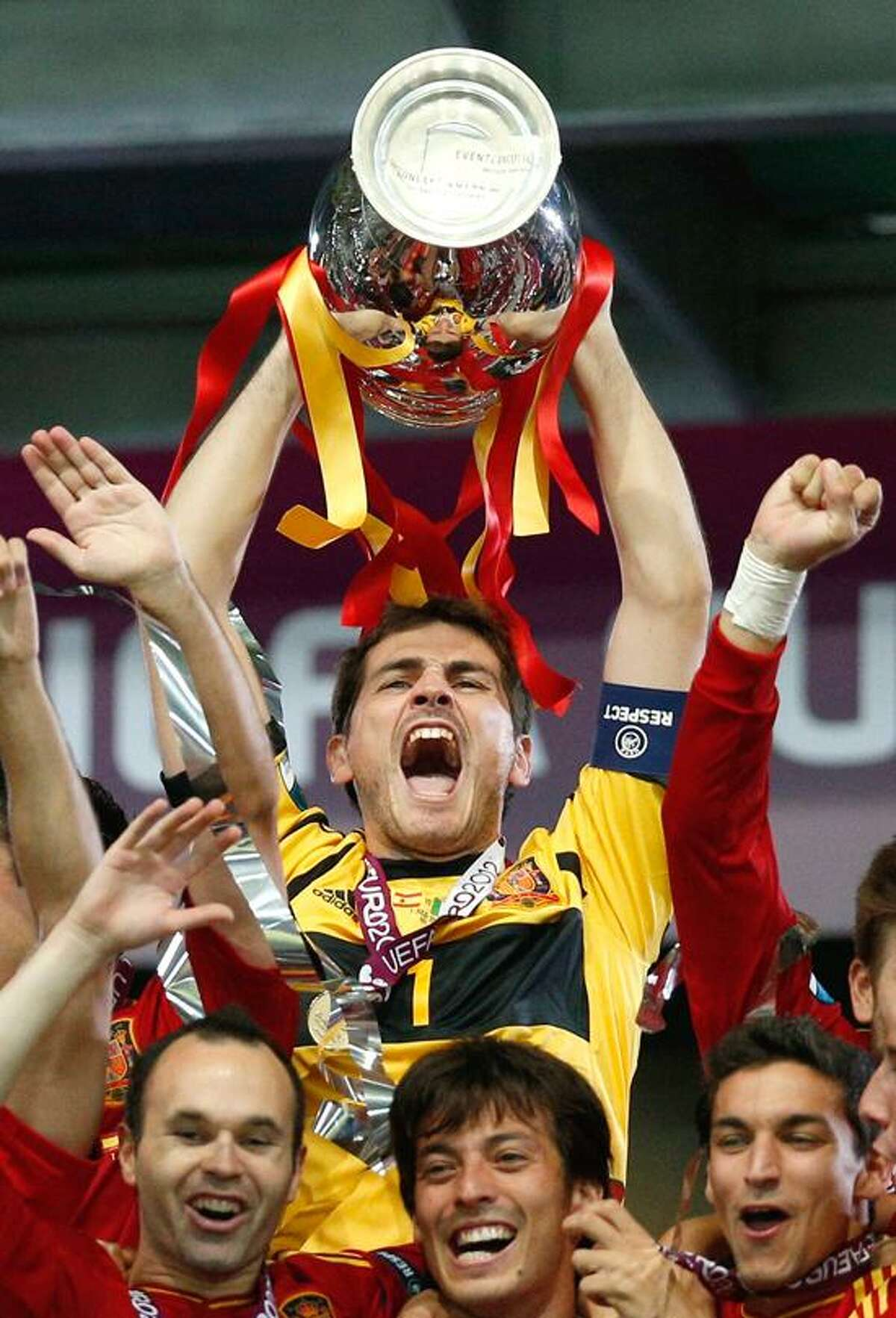 Spain goalkeeper Iker Casillas celebrate s with the trophy after the Euro 2012 soccer championship final between Spain and Italy in Kiev, Ukraine, Sunday, July 1, 2012. (AP Photo/Michael Sohn)
