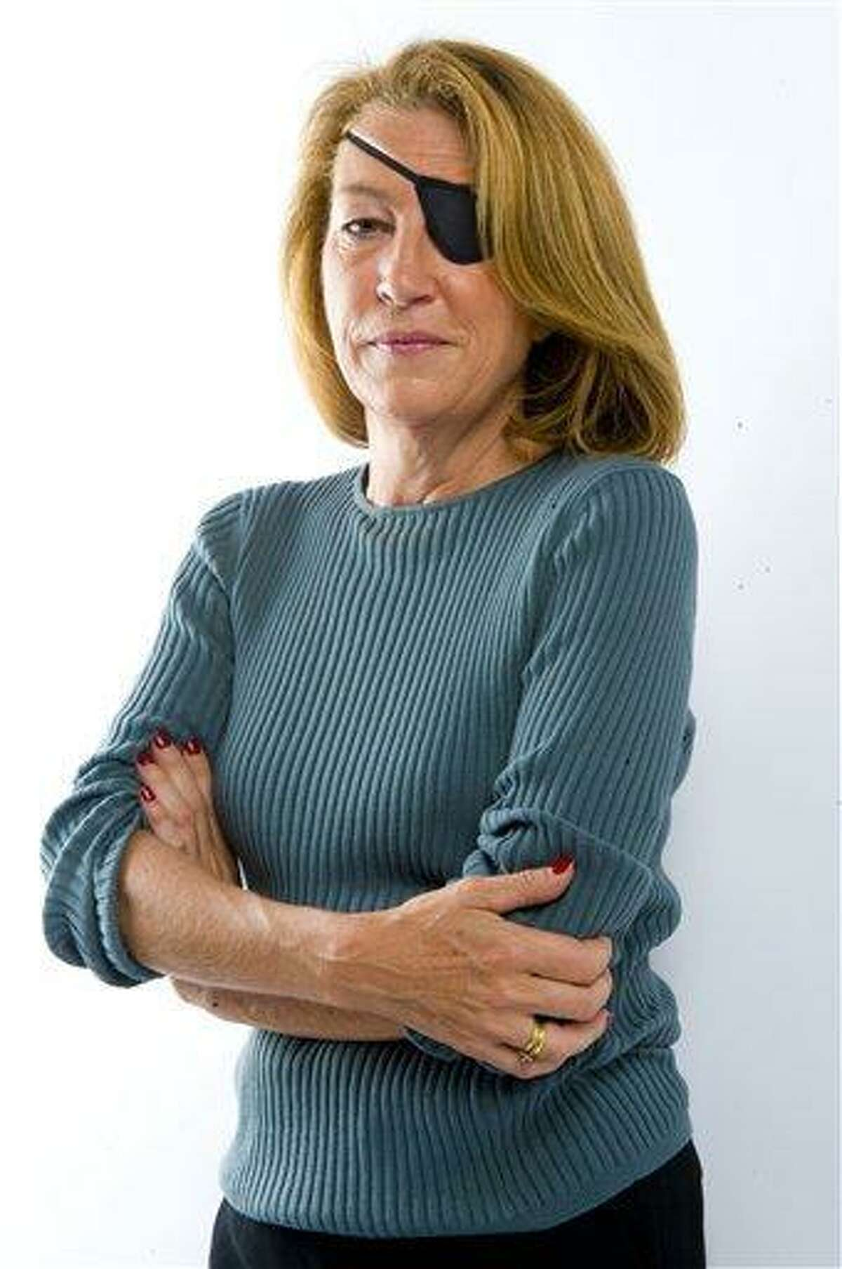 This is an undated image made available Wednesday by the Sunday Times in London of journalist Marie Colvin. A French government spokeswoman on Wednesday identified two Western reporters killed in Syria as American war reporter Marie Colvin and French photojournalist Remi Ochlik. Colvin, from Oyster Bay, New York, had been a foreign correspondent for Britain's Sunday Times for two decades, reporting from the world's most dangerous places. She lost the sight in one eye in Sri Lanka in 2001 but did not let that deter her. Associated Press