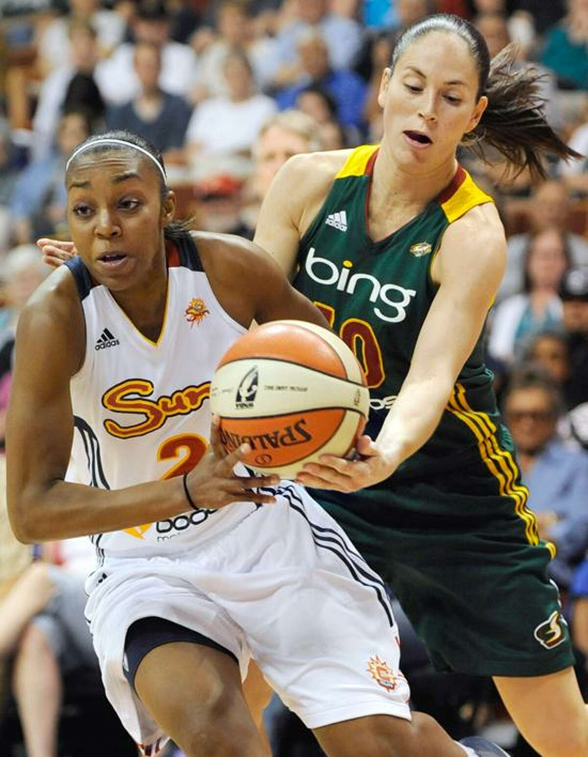 Connecticut Sun's Renee Montgomery, left, is pressured by Seattle Storm's Sue Bird in the first half of a WNBA basketball game in Uncasville, Conn., Sunday, July 1, 2012. (AP Photo/Jessica Hill)