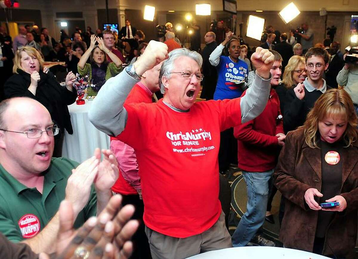 Former South Windsor Mayor John Pelkey (center) and a roomful of Chris Murphy supporters cheer the results of the Senate race at the Hilton Hotel in Hartford on 11/6/2012.Photo by Arnold Gold/New Haven Register