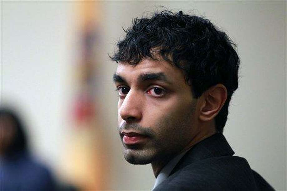 Dharun Ravi, a former Rutgers University student, waits before court proceedings March 9 in New Brunswick, N.J. Associated Press Photo: AP / Pool, The Star-Ledger