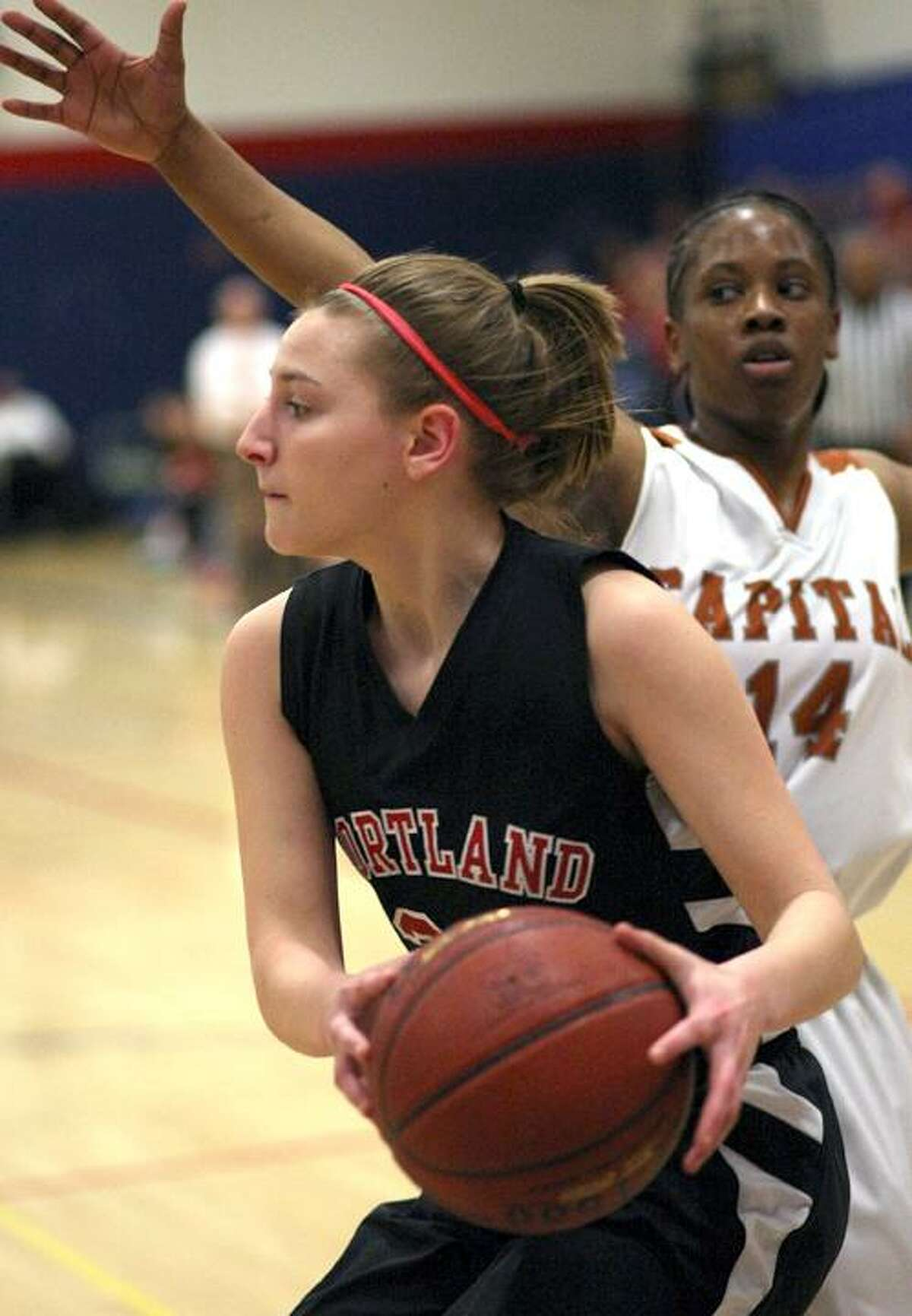 Special to the Press 03.12.12. Portland's Sarah Bierly finds a way past Kiah Gillespie in Monday's state class S semifinal game against Capital Prep. Prep won, 68-45. To buy a glossy print of this photo and more, visit www.middletownpress.com.
