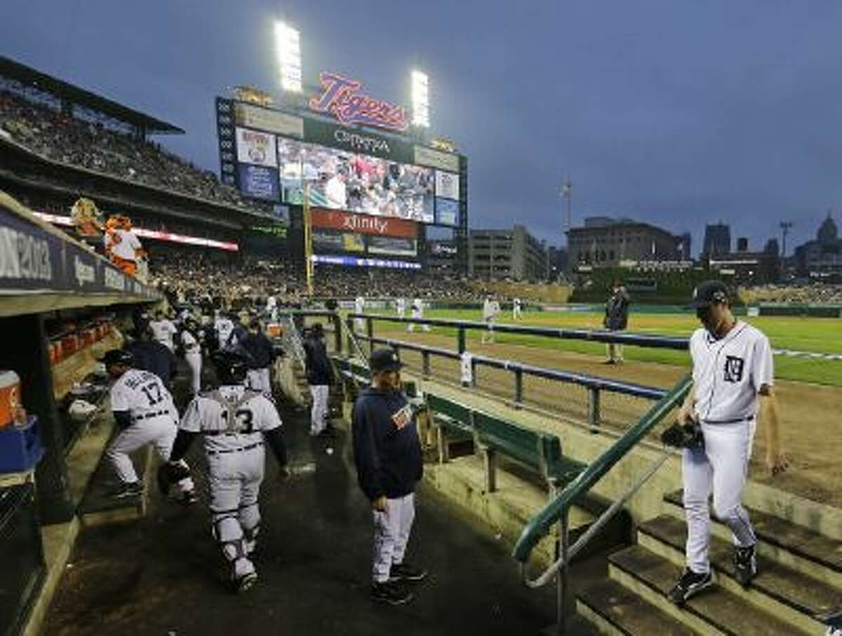 Detroit Tigers' Justin Verlander walks in the dugout after giving up a home run to Boston Red Sox's Mike Napoli in Game 3. The Red Sox won 1-0.
