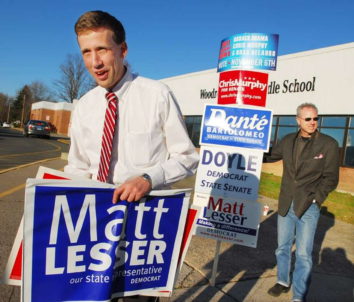 Catherine Avalone/The Middletown PressMatt Lesser, State Representative D-Middletown, campaigns in the 100th District Tuesday afternoon in front of Woodrow Wilson Middle School at 370 Hunting Hill Avenue in Middletown. Dan Pickett, Chairman of the Democratic Committee Town Committee is at right.