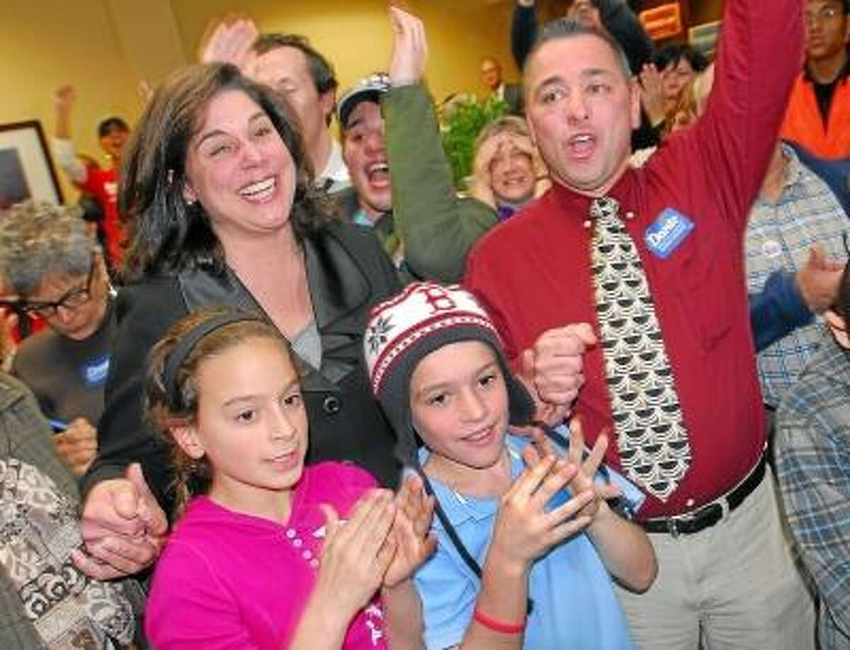 Catherine Avalone/The Middletown Press Democrat Dante Bartolomeo, of Meriden with her husband Doug and sons, Riley, 16 and Cameron, 10 at the headquarters 37 West Main Street in Meriden. Bartolomeo has been declared the winner awaiting absentee ballots from Meriden and Cheshire for 13th State Senate District.