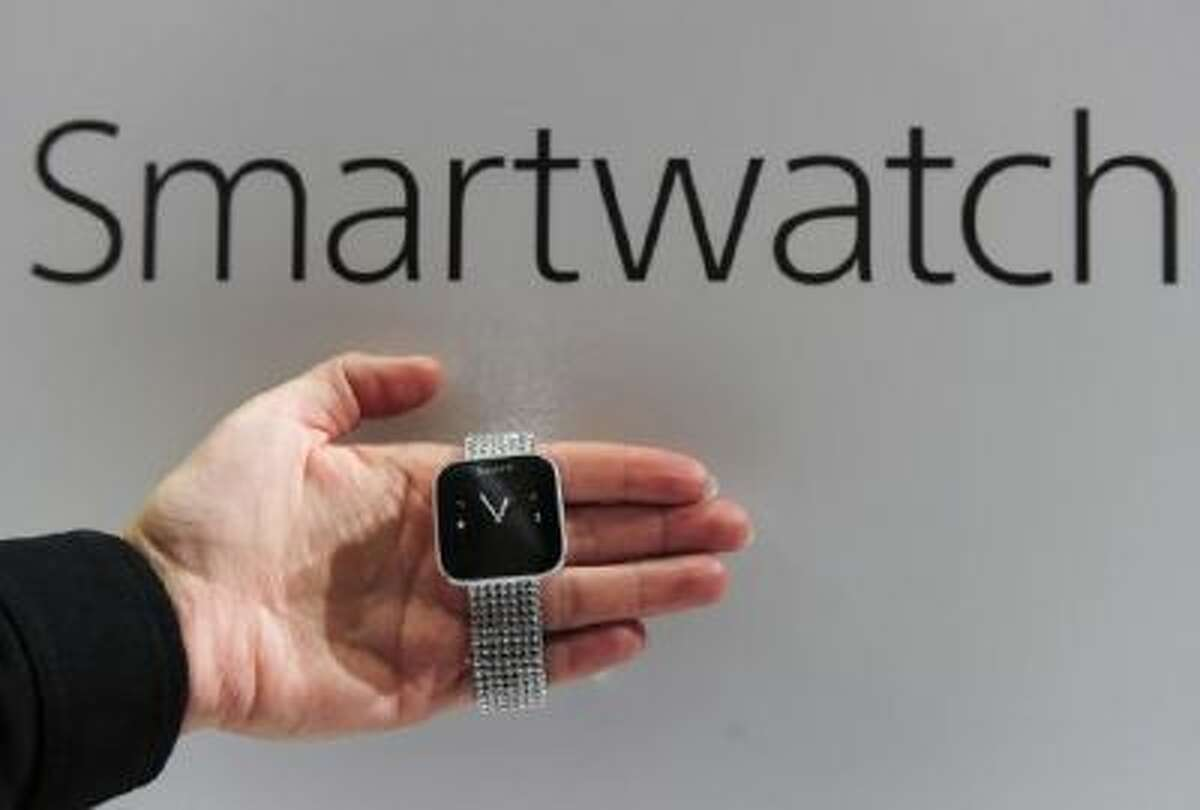 A hostess shows a smartwatch by Sony on Feb. 27, 2013 at the Mobile World Congress.