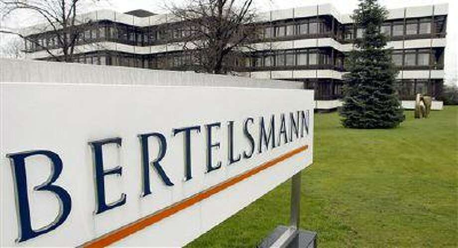 FILE - This March 13, 2003 file photo shows an outside view of the German media giant Bertelsmann in Guetersloh, Germany. Parent companies Bertelsmann and Pearson announced Monday, June 3, 2013, that the merger between Random House Inc. and Penguin Group has been cleared by anti-trust authorities in China, among the last countries to give approval. The new publishing house, Penguin Random House, will be 53 percent controlled by Bertelsmann and 47 percent by Pearson. (AP Photo/Michael Sohn, File) Photo: AP / AP