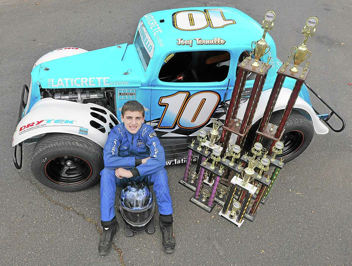 """Joey """"Joey Walnuts"""" Ternullo, 14, of Middletown, races in the Legends Division in his replica 1934 Ford Coupe at Waterford Speedbowl. Ternullo has earned 52 trophies in eight years of competition — eight this racing season alone."""