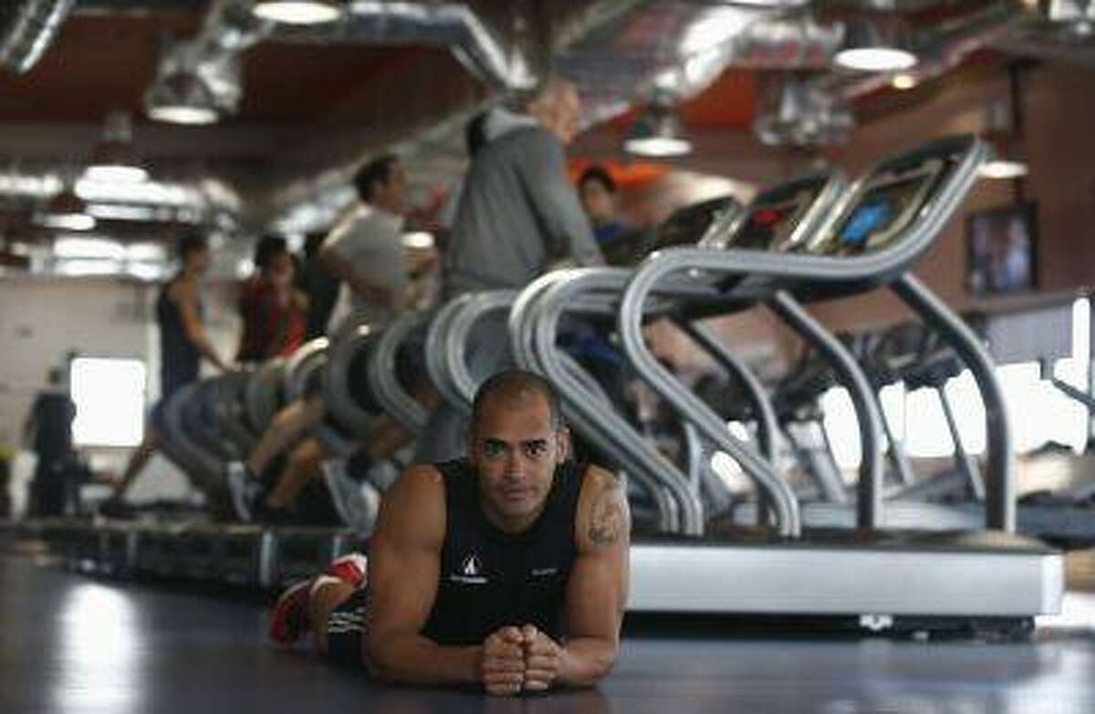 Nick Coutts, co-founder of the Fitness Hut gym chain, poses at one of its gyms. (REUTERS/Rafael Marchante)