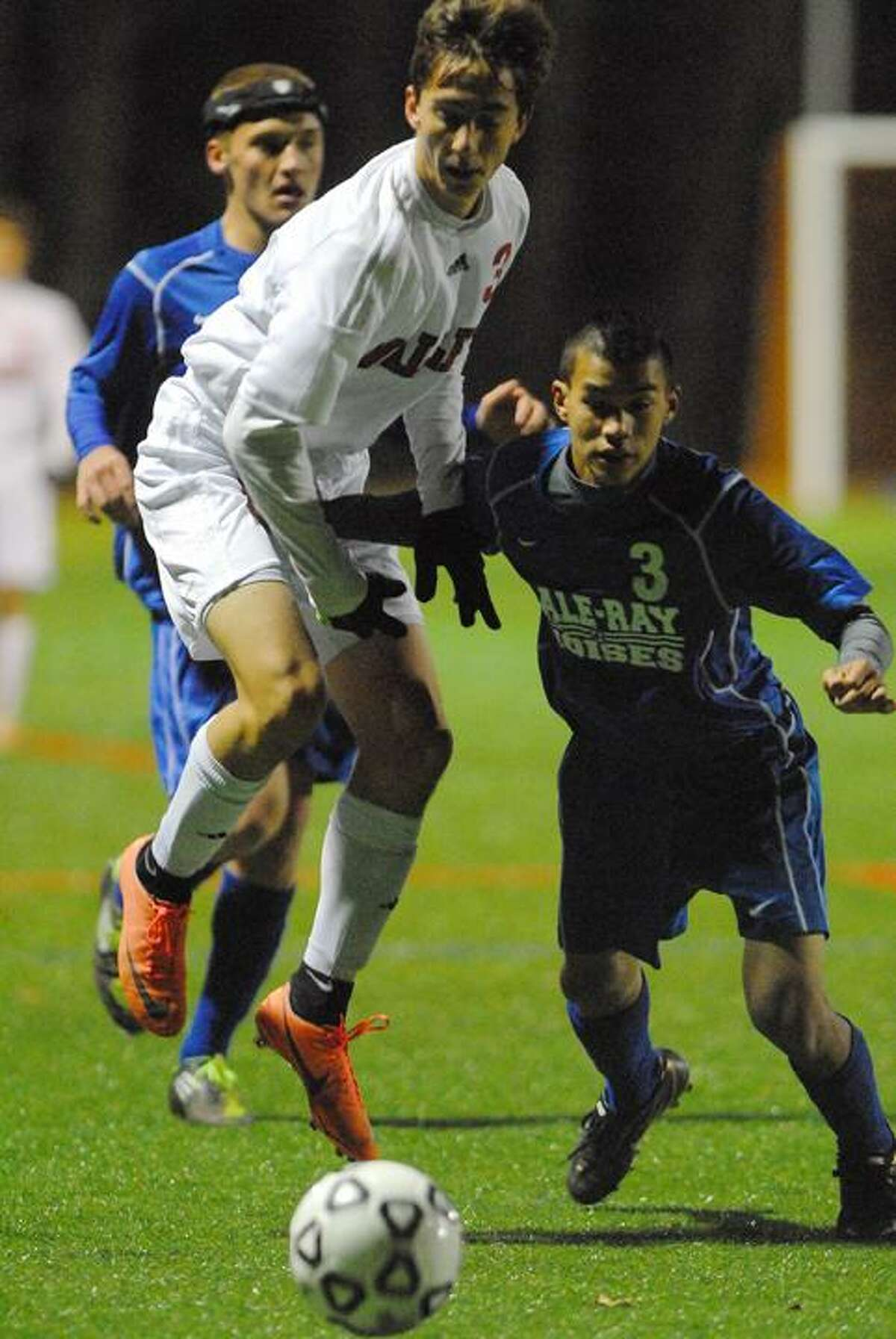 Catherine Avalone/The Middletown PressValley Regional senior Oskar Partyka and Hale Ray's Erick Tung battle for a loose ball in the first half of the Shoreline Championship match at Indian River Athletic Complex in Clinton Monday night.