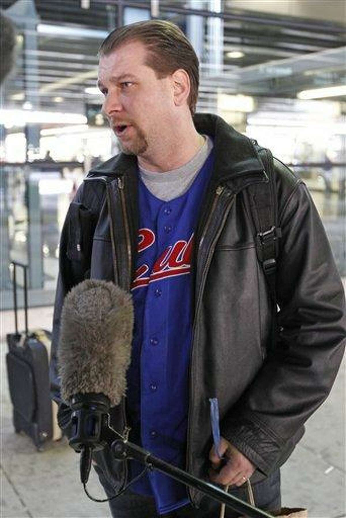Brad LeClear, a passenger on an American Airlines flight from Dallas to Chicago, talks to reporters upon landing in Chicago, after the flight was disrupted when a flight attendant ranted about the plane crashing Friday. The incident happened while the plane was preparing to take off from Dallas-Fort Worth International Airport. LeClear said he helped restrain the flight attendant, who he said acted oddly and mentioned something about the Sept. 11, 2001, attacks. Associated Press