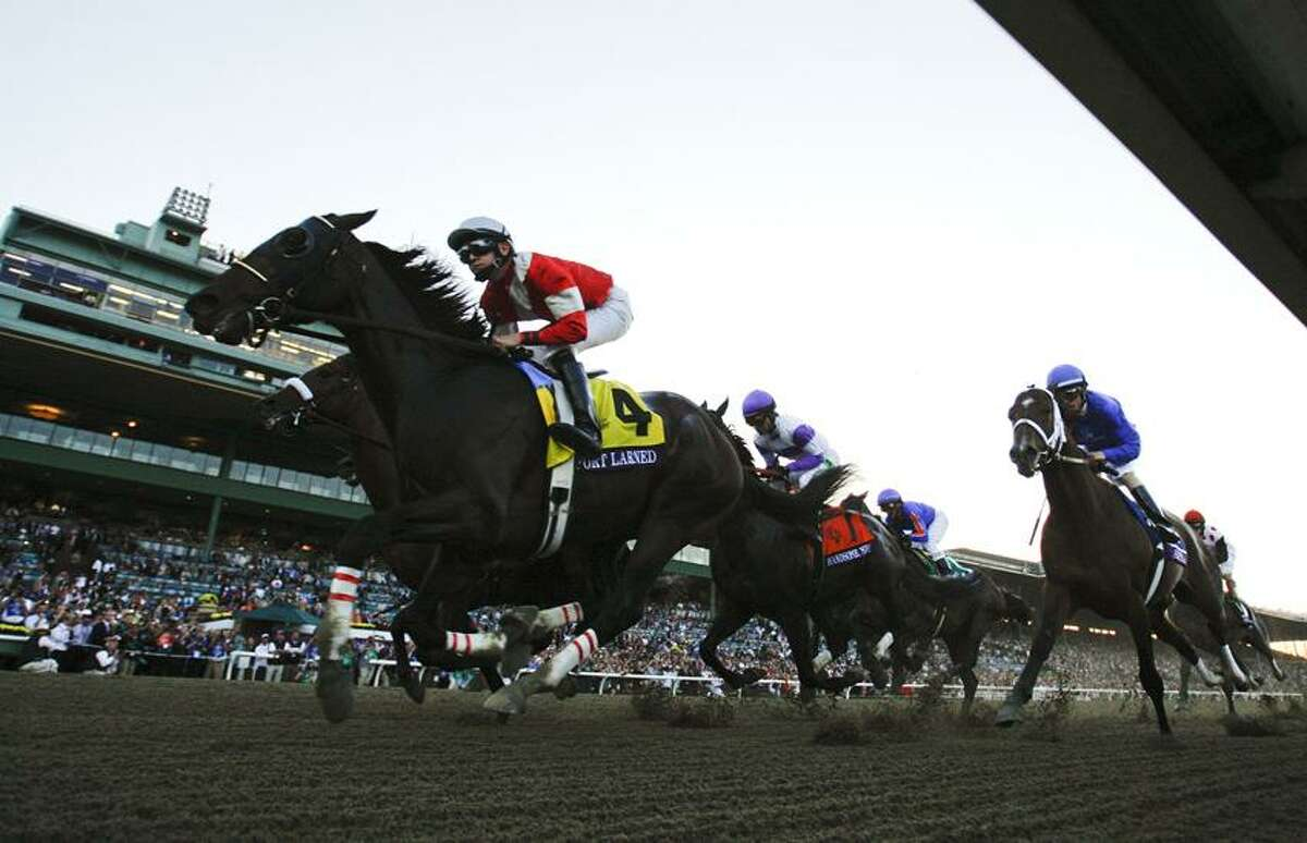 Brian Hernandez atop Fort Larned (4), leads the pack early during the running of the Breeders' Cup Classic horse race, Saturday, Nov. 3, 2012, at Santa Anita Park in Arcadia, Calif. (AP Photo/Mark J. Terrill)
