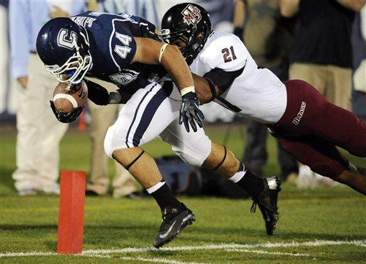 Connecticut's Max DeLorenzo (44) is hit at the 1 yard line by Massachusetts' in Khary Baily-Smith the second half of an NCAA college football game at Rentschler Field in East Hartford, Conn., Thursday, Aug. 30, 2012. Connecticut won 37-0. (AP Photo/Jessica Hill)