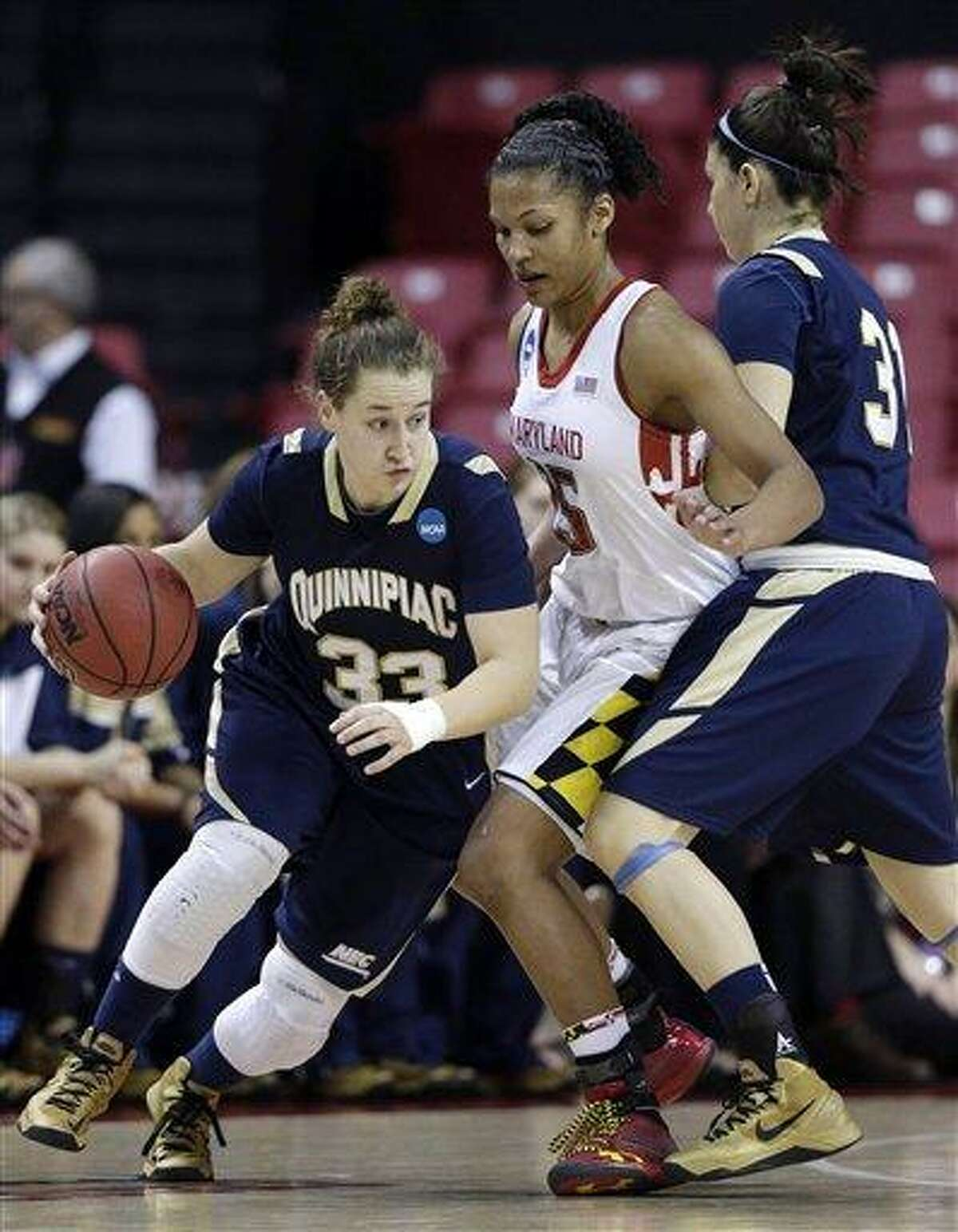 Quinnipiac guard Gillian Abshire, left, drives past Maryland forward Alyssa Thomas as she is screened by Quinnipiac forward Samantha Guastella during the second half of a first-round game in the women's NCAA college basketball tournament in College Park, Md., Saturday, March 23, 2013. (AP Photo/Patrick Semansky)