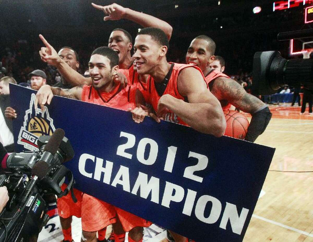 ASSOCIATED PRESS Louisville's Peyton Siva, left, celebrates with teammates after winning the Big East title against Cincinnati, 50-44 on Saturday night at Madison Square Garden in New York.