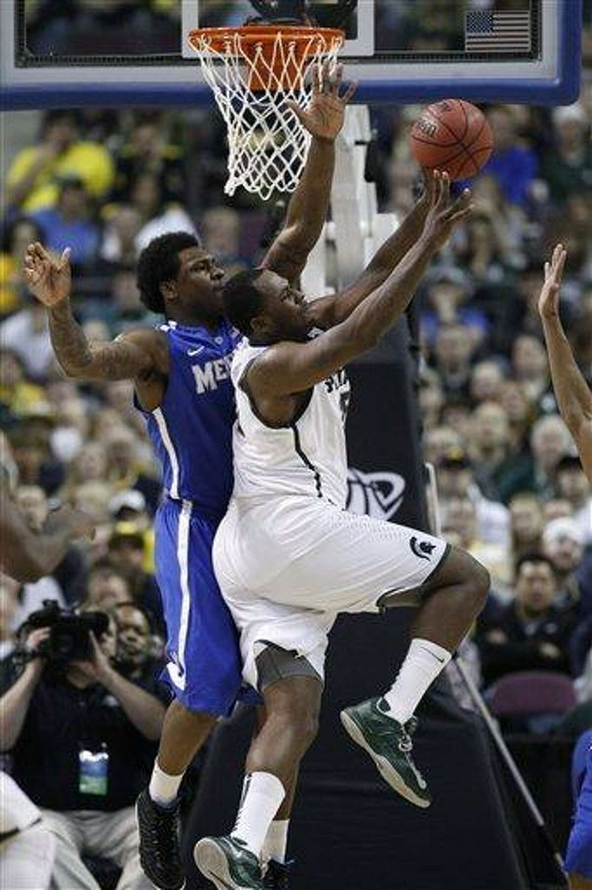 Michigan State forward Derrick Nix is forced to pass the ball against the defense of Memphis forward Tarik Black, left, in the second half of a third-round game of the NCAA college basketball tournament Saturday, March 23, 2013, in Auburn Hills, Mich. (AP Photo/Duane Burleson)