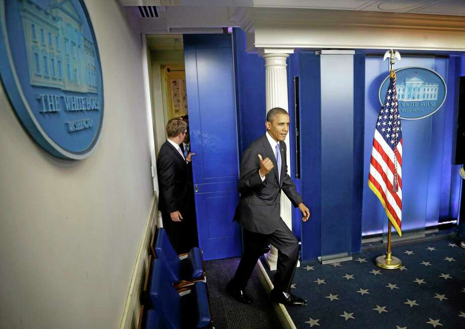 President Barack Obama walks out to make a statement to reporters in the Brady Press Briefing Room at the White House in Washington, Wednesday, Oct. 16, 2013. The Senate voted to avoid a financial default and reopen the government after a 16-day partial shutdown and the measure now heads to the House, which is expected to back the bill before day's end.  (AP Photo/Pablo Martinez Monsivais) Photo: AP / AP