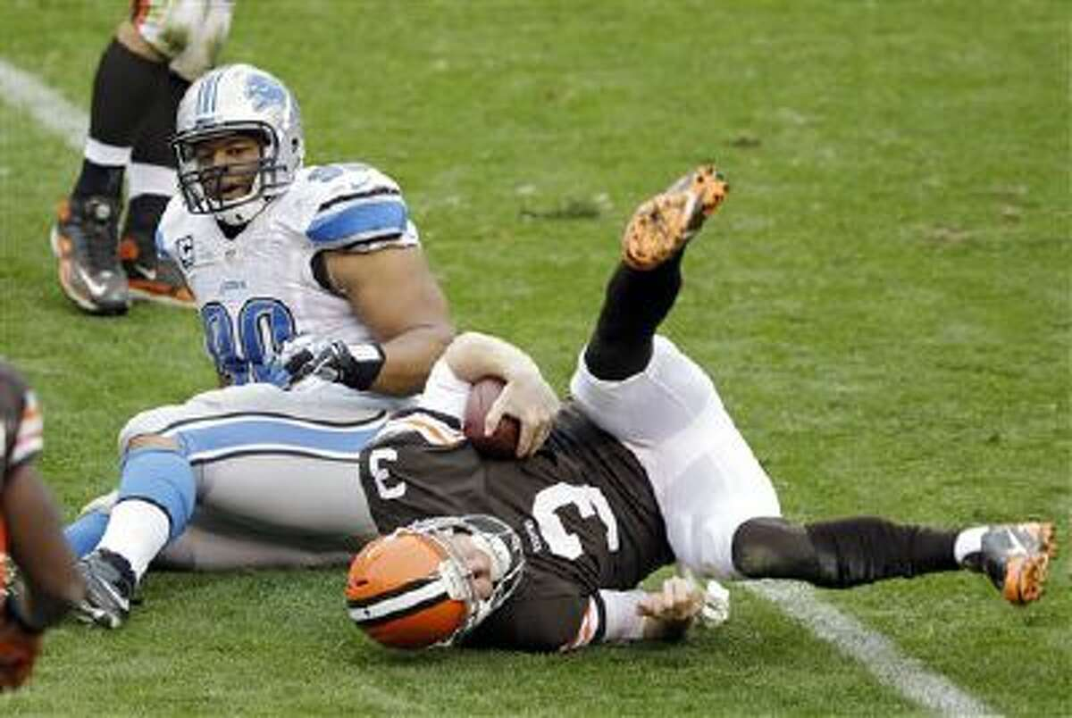 Detroit Lions defensive tackle Ndamukong Suh sacks Cleveland Browns quarterback Brandon Weeden in the third quarter of a game on Sunday.
