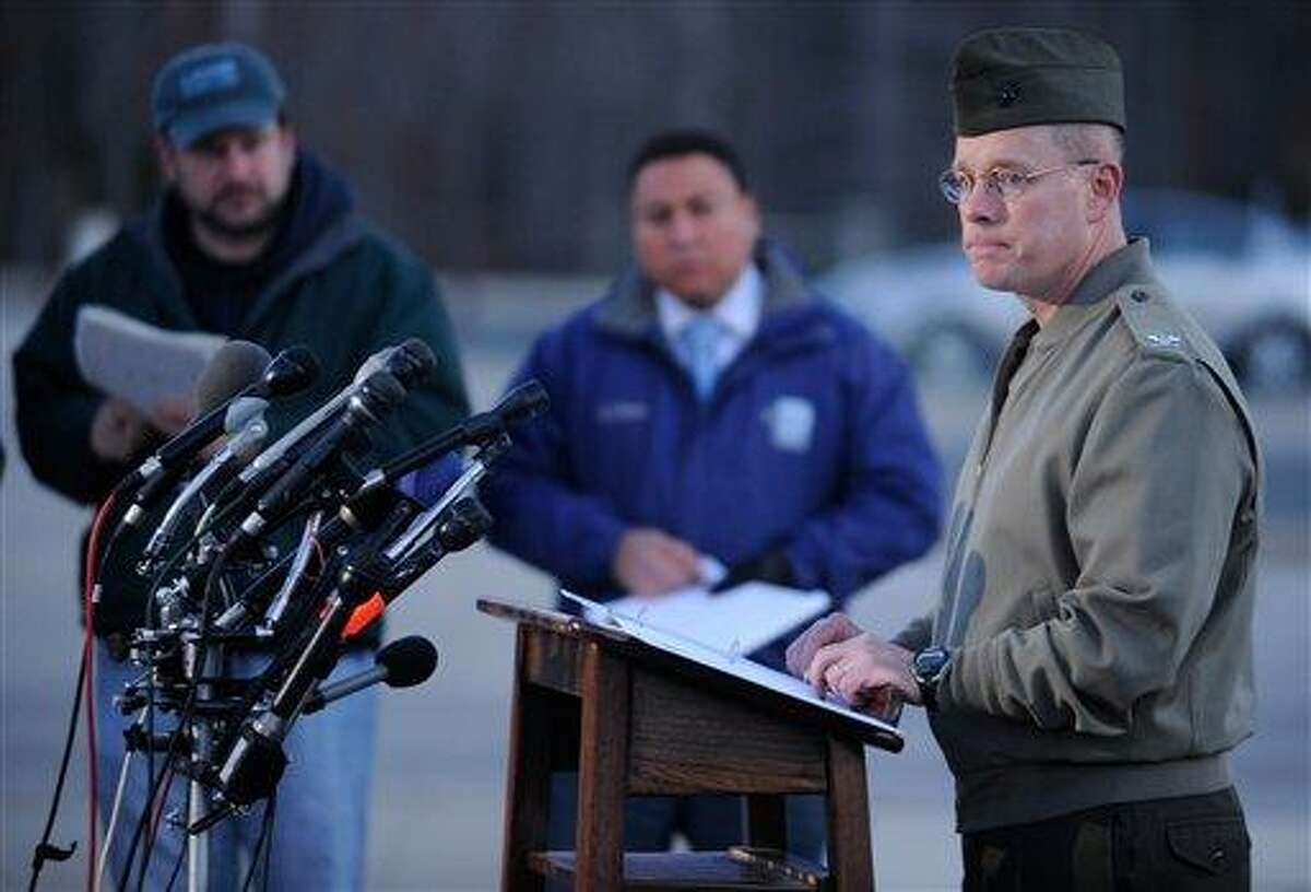 Col. David W. Maxwell holds a press conference at the Marine Corps Museum in Quantico, Va., on Friday, March 22, 2013 regarding a murder/suicide that occurred on Thursday night that resulted in the deaths of three Marines. A Marine killed a male and female colleague in a shooting at a base in northern Virginia before killing himself, officials said early Friday. (AP Photo/The Free Lance-Star, Peter Cihelka)