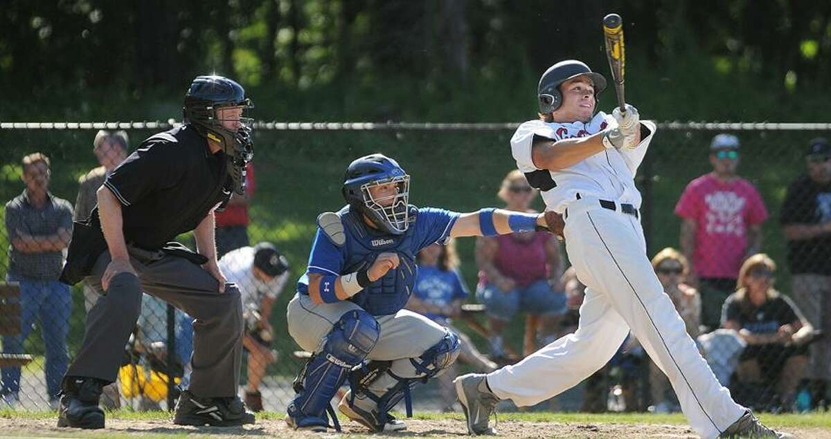 Catherine Avalone/The Middletown PressCromwell junior first baseman Logan Lessard at bat in the third inning against East Hampton in the Class S semi final game at Sgt. Zipadelli Field at Sage Park in Berlin Friday afternoon. Cromwell won 3-1 and advances to the state championship game.