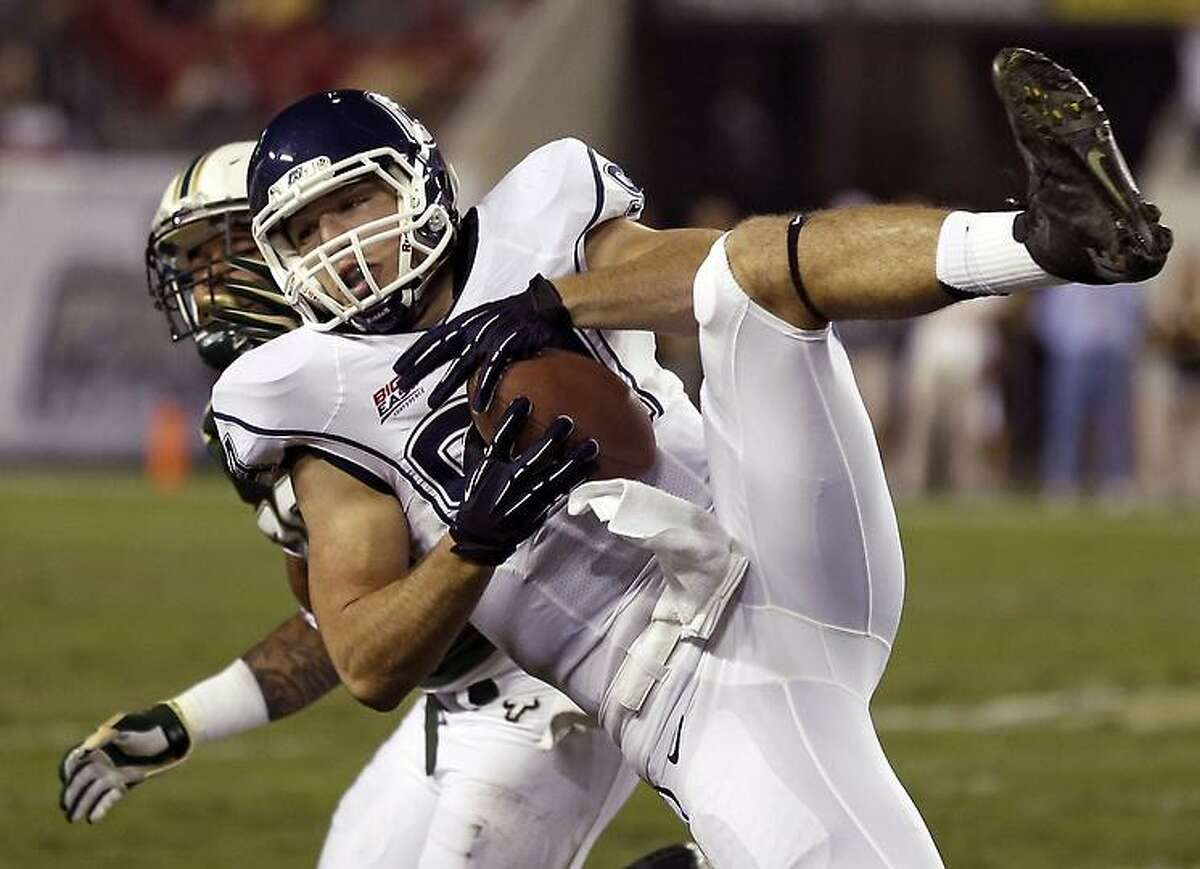 Connecticut tight end Ryan Griffin (94) makes a diving catch on a second quarter pass from quarterback Chandler Whitmer against South Florida during an NCAA college football game on Saturday, Nov. 3, 2012, in Tampa, Fla. (AP Photo/Chris O'Meara)