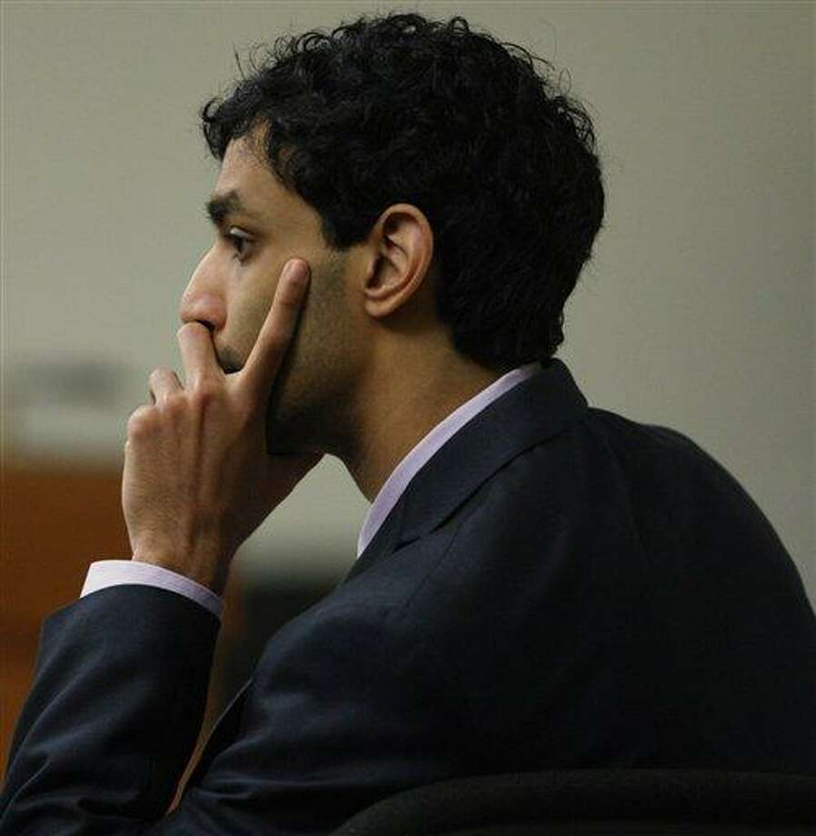 Former Rutgers University student Dharun Ravi listens during his trial Thursday in New Brunswick, N.J. Prosecutors rested their case in the trial, setting the stage for lawyers to begin their defense of the young man accused of using a webcam to spy on his roommate's intimate encounter with another man. Associated Press Photo: AP / Pool Home News Tribune
