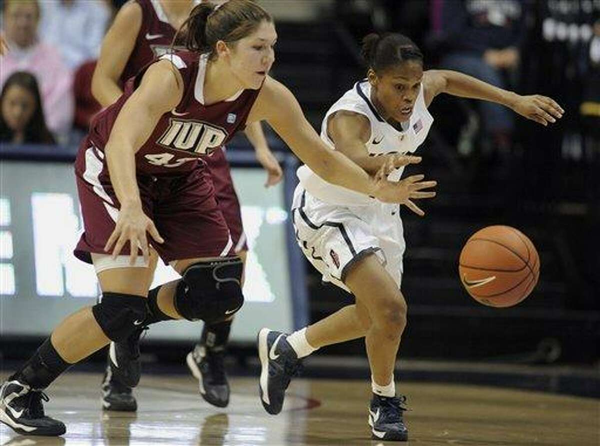 Connecticut's Moriah Jefferson, right, steals the ball from Indiana of Pennsylvania's Sarah Pastorek during the first half of a college exhibition basketball game in Storrs, Conn., Friday, Nov. 2, 2012. (AP Photo/Jessica Hill)