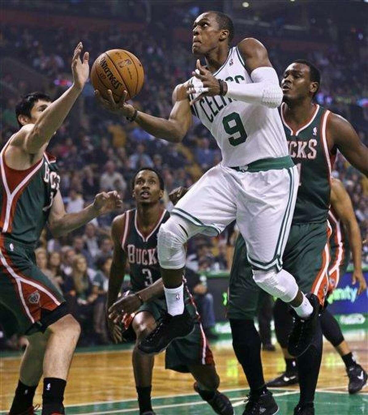 Boston Celtics guard Rajon Rondo drives to the basket against the Milwaukee Bucks in the first quarter of an NBA basketball game in Boston, Friday, Nov. 2, 2012. (AP Photo/Charles Krupa)