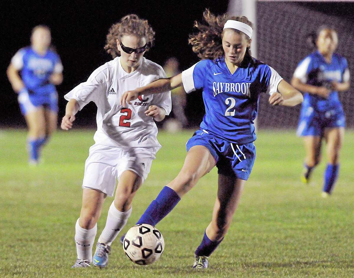 Saybrook defender Amanda Simoni challenges Cromwell forward Erin Glynn in the second half of Tuesday's game in Cromwell. The Panthers won 2-1.