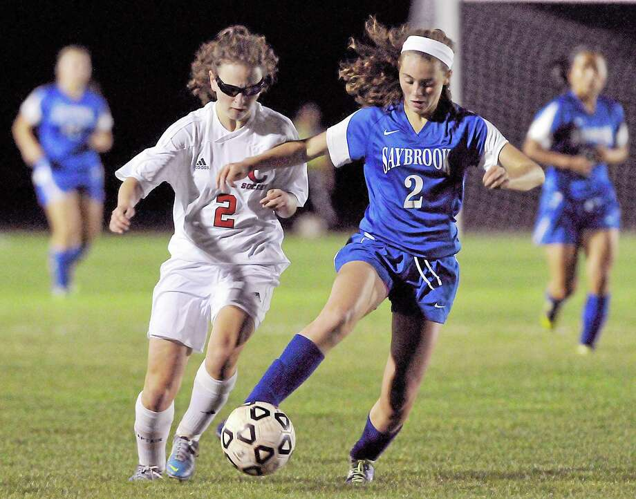Saybrook defender Amanda Simoni challenges Cromwell forward Erin Glynn in the second half of Tuesday's game in Cromwell. The Panthers won 2-1. Photo: Catherine Avalone — The Middletown Press  / TheMiddletownPress