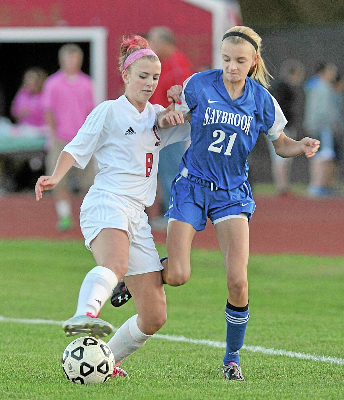 Cromwell midfielder Emma Belcourt moves the ball around Saybrook's Holly Coppes in Tuesday's game in Cromwell. Belcourt scored in the first half with 16:52 left on the clock. The Panthers won 2-1.