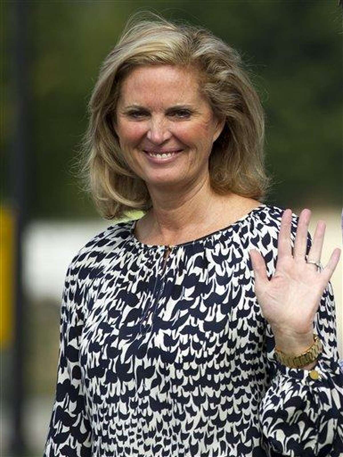 Ann Romney, Republican presidential candidate, former Massachusetts Gov. Mitt Romney, waves as she leaves Brewster Academy after working on convention preparations with her husband, Monday, Aug. 27, 2012, in Wolfeboro, N.H. (AP Photo/Evan Vucci)