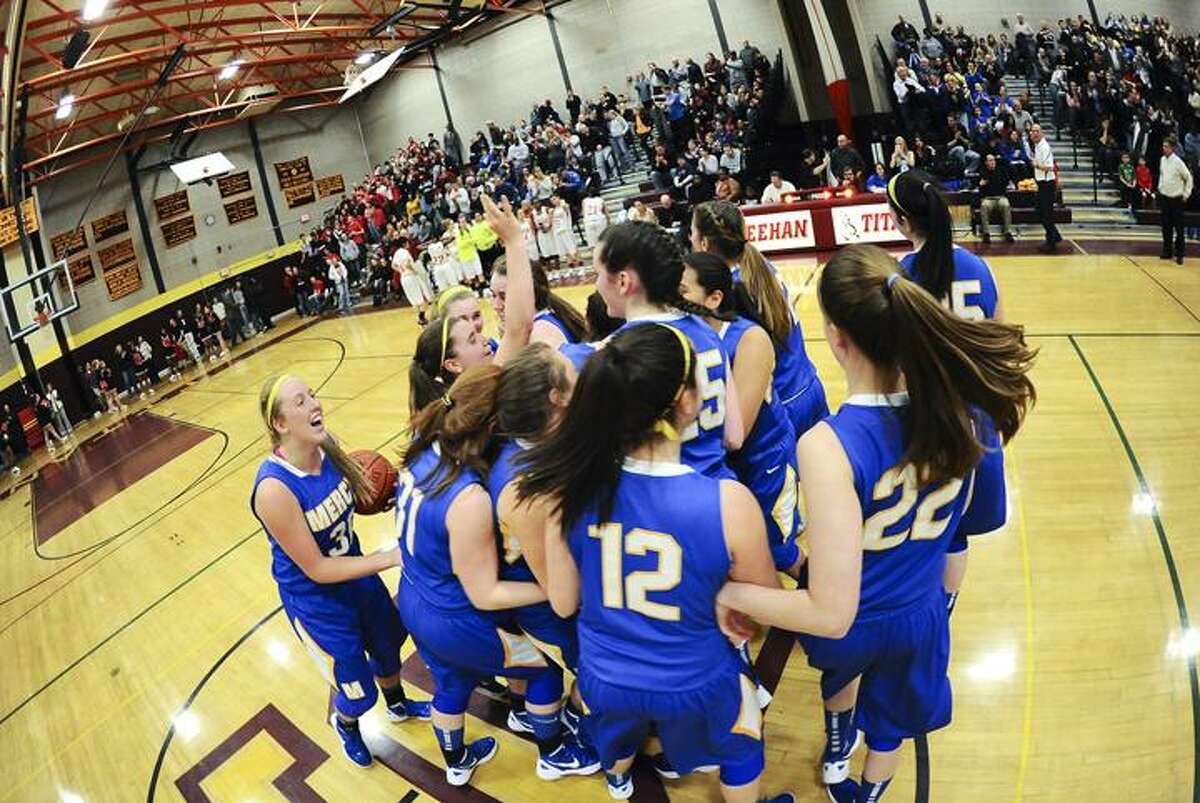 Mercy celebrates it's 52-38 victory over Manchester Friday night. Photo by Steve McLaughlin/The Middletown Press